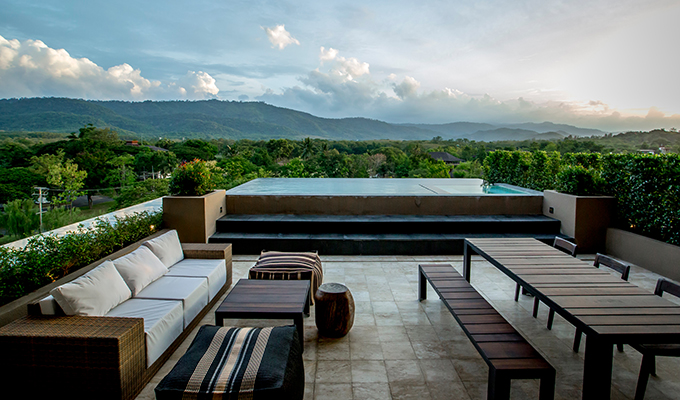 A spectacular rooftop penthouse to enjoy a panoramic view of mountain and verdant green forest.