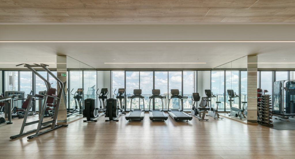 800-meter Active Floor on the 49th floor of Park 24, comprising cutting-edge cardio machines and weight lifting equipment